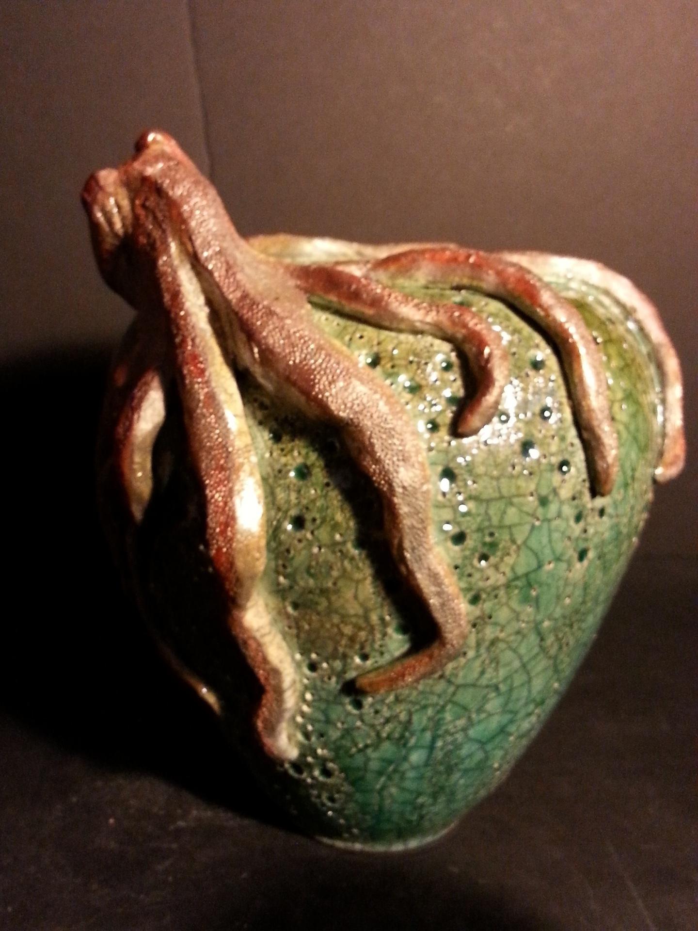 Hand built octopus, raku fired